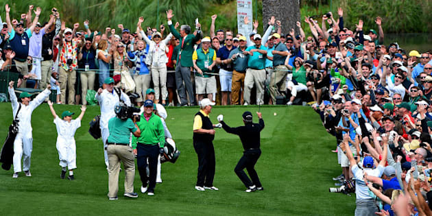 Gary Player, right, and the gallery react to his hole-in-one from the seventh tee box during the Par 3 contest on Wednesday, April 6, 2016, at Augusta National Golf Club in Augusta, Ga. (Jeff Siner/Charlotte Observer/TNS via Getty Images)