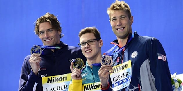 Australia's Mitchell Larkin (C), gold, France's Camille Lacourt (L), silver, and USA's Matt Grevers pose during the podium ceremony of the men's 100m backstroke swimming event at the 2015 FINA World Championships in Kazan on August 4, 2015.   AFP PHOTO / MARTIN BUREAU        (Photo credit should read MARTIN BUREAU/AFP/Getty Images)