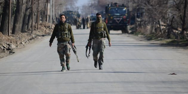 PAMPORE, KASHMIR-INDIA FEBRUARY 22: Special operation group cops patrol nearthe encounter site in Pampore some 15 kilometers from Srinagar the summer capital of Indian controlled Kashmir on February 22, 2016.N ine persons including two Indian army captains, three CRPF soldiers, three militants and a civilian were killed when suspected militants attacked a military convoy on Srinagar National highway near Pampore, the militants then took refuge in a nearby government building where a fierce gunbattle between government forces and militants took place, Indian army said. (Photo by Faisal Khan/Anadolu Agency/Getty Images)