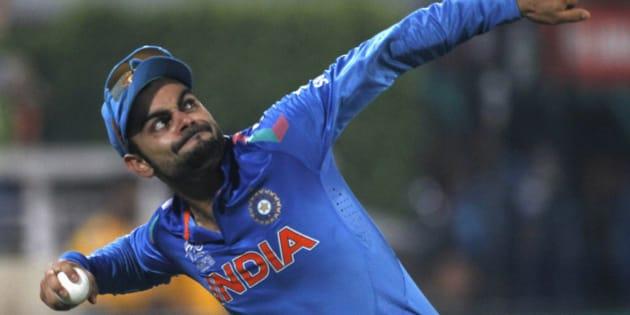 India's Virat Kohli celebrates as he catches a ball to dismiss Sri Lanka's Tillakaratne Dilshan successfully during their ICC Twenty20 World Cup cricket final match at the Sher-E-Bangla National Cricket Stadium in Dhaka April 6, 2014. REUTERS/Andrew Biraj (BANGLADESH - Tags: SPORT CRICKET)