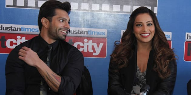 NEW DELHI, INDIA - JANUARY 13: Bollywood director Bhushan Patel and actor Bipasha Basu and Karan Singh Grover during an exclusive interview with HT City, Hindustan Times, to promote their upcoming movie Alone at HT Media Office on January 13, 2015 in New Delhi, India. Alone is an upcoming Indian horror film scheduled to release on January 16, 2015. (Photo by Waseem Gashroo/Hindustan Times via Getty Images)