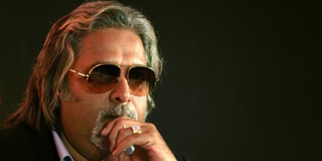 Kingfisher Airlines Chairman Vijay Mallya attends a news conference in Mumbai in this February 6, 2007 file photo. To match feature MOTOR-RACING/INDIA   REUTERS/Adeel Halim/Files (INDIA)