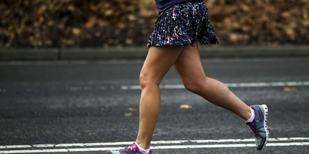 A woman jogs in her shorts during a warm day in Central Park, New York December 25, 2015. Much of the U.S. East Coast could see record high temperatures on Christmas Day and through the weekend even as a major winter storm looms for the southern Great Plains, forecasters said on Friday. REUTERS/Eduardo Munoz