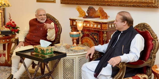 Pakistani Prime Minister Nawaz Sharif (R) talks with his Indian counterpart Narendra Modi in Lahore, Pakistan, December 25, 2015. Modi arranged his landmark visit to Pakistan - the first by an Indian leader in a decade, at the last minute on Friday, a Pakistani official said. REUTERS/Press Information Department (PID)/Handout via Reuters ATTENTION EDITORS - FOR EDITORIAL USE ONLY. NOT FOR SALE FOR MARKETING OR ADVERTISING CAMPAIGNS. THIS IMAGE HAS BEEN SUPPLIED BY A THIRD PARTY. IT IS DISTRIBUTED, EXACTLY AS RECEIVED BY REUTERS, AS A SERVICE TO CLIENTS   NO RESALES. NO ARCHIVE