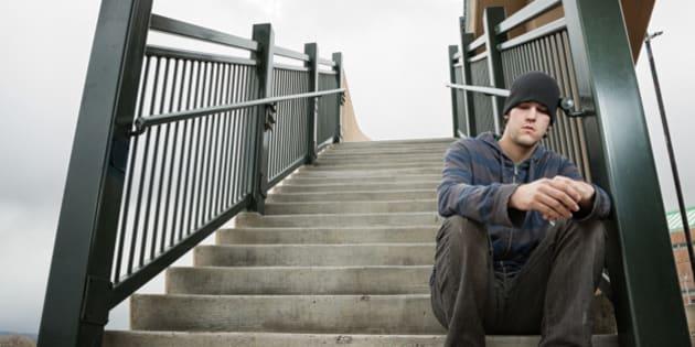 Sad young man thinking