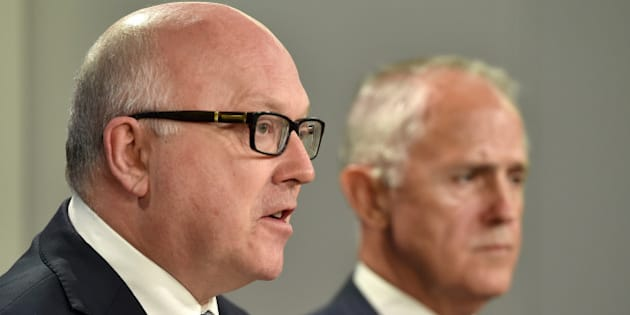 Australia's Attorney General George Brandis (L) speaks at a press conference Australia's Prime Minister Malcolm Turnbull looks on in Sydney on December 30, 2015.  An Australian inquiry into trade union corruption reported 'widespread' and 'deep-seated' misconduct, with Turnbull urging reform and the establishment of an independent regulator.    AFP PHOTO / Saeed KHAN / AFP / SAEED KHAN        (Photo credit should read SAEED KHAN/AFP/Getty Images)