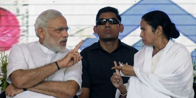 ASANSOL, INDIA - MAY 10: Prime Minister Narendra Modi and Chief Minister Mamata Banerjee during the inauguration of '2.5 MT modernized & expanded IISCO Steel Plant' at Burnpur Polo Ground in the district Burdwan of West Bengal, on May 10, 2015 in Asansol, India. During the function, Modi described the Union Government and 29 State Governments as 30 pillars of 'TEAM INDIA' which would take India forward. The upgraded steel plant of IISCO (Indian Iron and Steel Co) that has the country's largest blast furnace and has been modernised at a cost of Rs.16,000 crore. (Photo by Subhendu Ghosh/Hindustan Times via Getty Images)