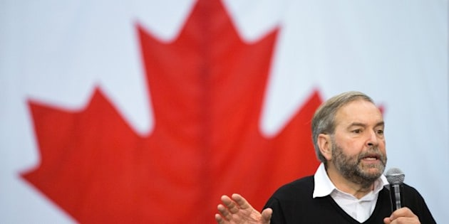 NDP leader Thomas Mulcair speaks at a campaign rally in London, Ontario October 4, 2015. New polling showed the former frontrunner in Canada's legislative elections could finish third over its opposition to a popular niqab ban, as political leaders squared off in a final debate October 2. The race is still too close to call, with the rivals sparring over taxes, trade negotiations, the Syrian refugee crisis, air strikes against the Islamic State group, and upcoming Paris climate talks.Thomas Mulcair's New Democrats jumped into the lead at the start of the race in July and held it through most of the campaign. AFP PHOTO/GEOFF ROBINS        (Photo credit should read GEOFF ROBINS/AFP/Getty Images)