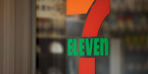 The 7-Eleven logo is displayed at a convenience store, operated by Seven & i Holdings Co., in Kawasaki City, Kanagawa Prefecture, Japan, on Tuesday, April 5, 2016. Seven & i is scheduled to report earnings on April 7. Photographer: Akio Kon/Bloomberg via Getty Images