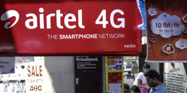 An advertisment for Bharti Airtel Ltd. sits outside a sim card vendor's stall in Mumbai, India, on Monday, Oct. 19, 2015. Bharti, Indias largest wireless carrier, is scheduled to announce earnings on Oct. 26. Photographer: Dhiraj Singh/Bloomberg via Getty Images