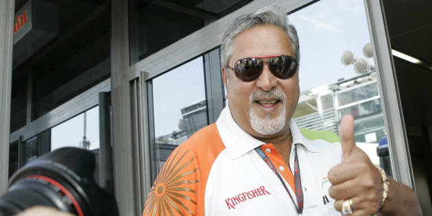 Force India team principal Vijay Mallya gives the thumb up sign after Force India driver Adrian Sutil of Germany was the fastest in final practice ahead of qualifying for Sunday's Italian Formula One Grand Prix, at the Monza racetrack, Saturday, Sept. 12, 2009. (AP Photo/Alberto Pellaschiar)
