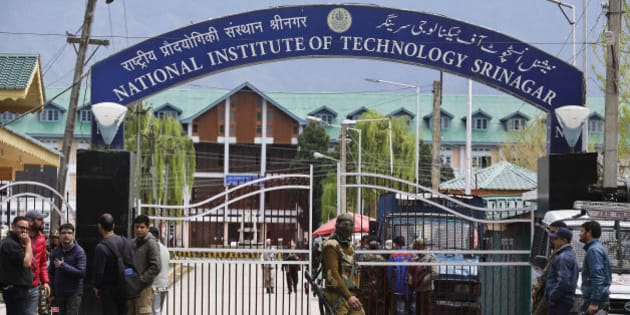 An Indian security personnel guards the entrance to the National Institute of Technology (NIT), in Indian controlled Kashmir, Thursday, April 7, 2016. A clash took place between students of Kashmiri origin and others during the West Indies-India World Cup T20 semi-final match, after Kashmiri students allegedly celebrated India's loss. Classes had to be suspended after several students sustained injuries. (AP Photo/Mukhtar Khan)