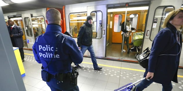 A Belgian police officer patrols in a metro station in Brussels, a week after the bomb attacks at the Brussels metro and Belgian international airport of Zaventem, in Brussels Belgium,  March 29, 2016.   REUTERS/Yves Herman