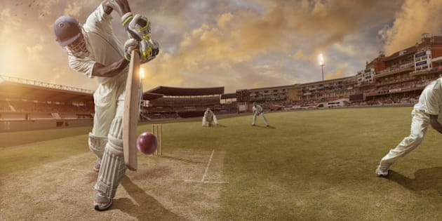 Batsman just after hitting ball in professional cricket match in full stadium at sunset during summer.Stadium is fake created in photoshop.