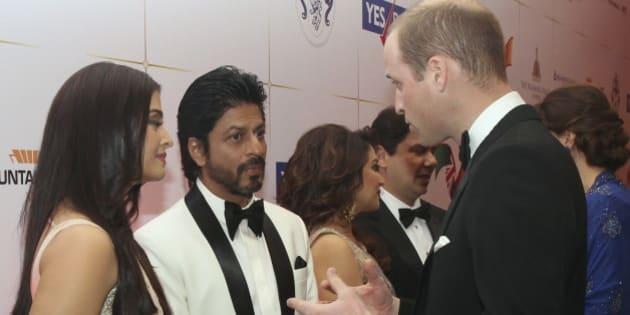 Britain's Prince William speaks to Bollywood actors Shah Rukh Khan and Aishwarya Rai at reception at Taj hotel in Mumbai, India, Sunday, April 10, 2016. REUTERS/Rafiq Maqbool/Pool