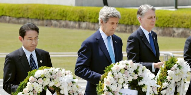 U.S. Secretary of State John Kerry (2nd L) prepares to lay a wreath at the cenotaph with Japan's Foreign Minister Fumio Kishida (L), Britain's Foreign Minister Philip Hammond and other fellow G7 foreign ministers at Hiroshima Peace Memorial Park and Museum in Hiroshima, Japan, in this photo released by Kyodo April 11, 2016. Mandatory credit REUTERS/Kyodo  ATTENTION EDITORS - FOR EDITORIAL USE ONLY. NOT FOR SALE FOR MARKETING OR ADVERTISING CAMPAIGNS. MANDATORY CREDIT. JAPAN OUT. NO COMMERCIAL OR EDITORIAL SALES IN JAPAN. THIS IMAGE WAS PROCESSED BY REUTERS TO ENHANCE QUALITY, AN UNPROCESSED VERSION WILL BE PROVIDED SEPARATELY.