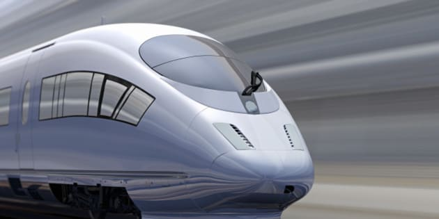 Blurred motion of high speed train, track and buildings