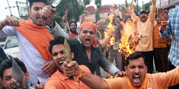 JAMMU, INDIA - APRIL 6: Activists of Vishav Hindu Parishad burning tyres during a protest against ongoing unrest at the National Institute of Technology (NIT) in Srinagar, on April 6, 2016 in Jammu, India. Trouble erupted at the NIT after India lost the World T20 semi-final match to West Indies on March 31. Some engineering students from outside the state claimed Kashmiri students had chanted anti-India slogans and burst firecrackers after India lost. (Photo by Nitin Kanotra/Hindustan Times via Getty Images)