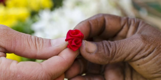 MADURAI, TAMIL NADU, INDIA - 2011/01/07: Little artificial flower given to a tourist for gift as a sign for being welcome. (Photo by Frank Bienewald/LightRocket via Getty Images)