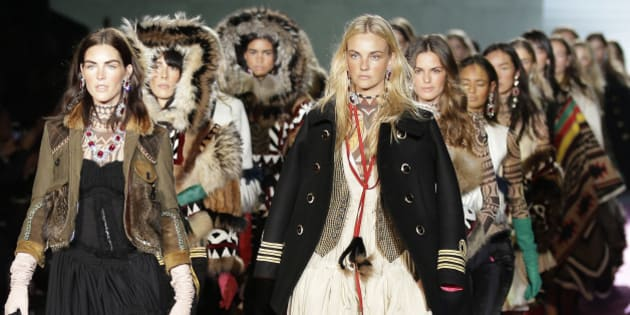 Models wear creations for DSquared2 women's Fall-Winter 2015-2016 collection, part of the Milan Fashion Week, unveiled in Milan, Italy, Monday, March 2, 2015. (AP Photo/Antonio Calanni)