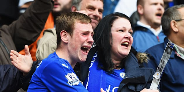 LEICESTER, ENGLAND - APRIL 03:  Leicester City fans show their emotions as they celebrate victory after the Barclays Premier League match between Leicester City and Southampton at The King Power Stadium on April 3, 2016 in Leicester, England.  (Photo by Laurence Griffiths/Getty Images)