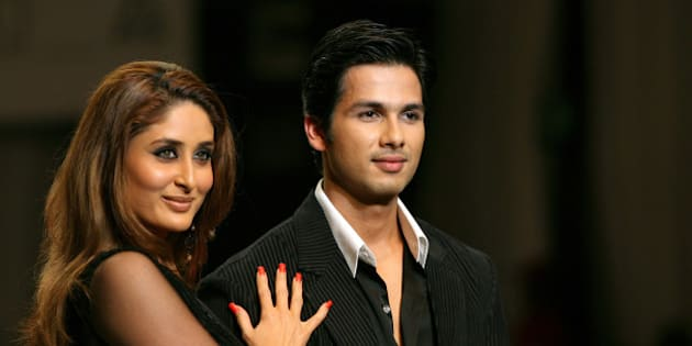 Bollywood actors Kareena Kapoor (L) and Shahid Kapur present creations by Indian designer Manish Malhotra at a fashion show on the final-day of the India fashion week in New Delhi September 3, 2006. REUTERS/Vijay Mathur (INDIA)