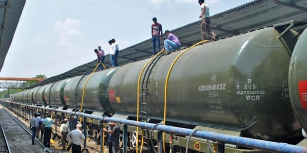 SANGLI, INDIA - APRIL 11: Workers feeling water tankers train carrying water to drought affected areas in Latur district on April 11, 2016 from Miraj Station near Sangli, India. 50 wagons with 1 million litres of water would reach Latur, providing much-needed relief to drought-hit Marathwada. Section 144 was imposed in Latur a fortnight ago after water tankers were being attacked by thirsty residents. (Photo by Uday Deolekar/Hindustan Times via Getty Images)