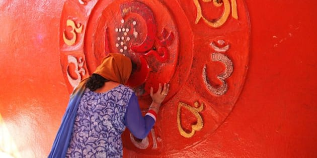 An Indian Hindu woman devotee prays at a temple on the occasion of the Mahashivratri festival in Jammu, India, Monday, March 7, 2016. Hindus across the world are celebrating Mahashivratri, or Shiva's night festival believed to be the day when Shiva got married. (AP Photo/Channi Anand)