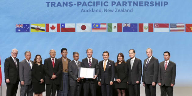 Trade delegates pose for a photograph after signing the Trans-Pacific Partnership Agreement in Auckland, New Zealand, Thursday, Feb. 4, 2016. Trade ministers from 12 Pacific Rim countries including the United States have ceremonially signed the free-trade deal. (David Rowland/SNPA via AP) NEW ZEALAND OUT