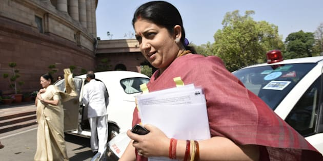 NEW DELHI, INDIA - MARCH 9: Union HRD Minister Smriti Irani at Parliament House on March 9, 2016 in New Delhi, India. Replying to the motion of thanks in the Parliament, Prime Minister Narendra Modi called on the Rajya Sabha to work in tandem with the Lok Sabha in passing important bills. (Photo by Arvind Yadav/Hindustan Times via Getty Images)