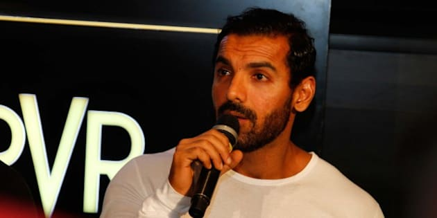 GREATER NOIDA, INDIA  MARCH 27: Bollywood actor John Abraham during the launch of Logix City Center and PVR Superplex on March 27, 2016 in Greater Noida, India. Speaking at the launch, Shakti Nath, Chairman and MD, Logix Group, said, Spread over six acres, City Center has been designed to become India's premier shopping and entertainment hub. It is a destination in itself, housing the best of national and international retail brands, F&B outlets and will provide a superb movie experience, making Noida the newest entertainment capital of the country. Well-known real estate company Logix Group launched Logix City Center, a one-stop lifestyle destination for customers of all ages, in Noida's sector 32. City dwellers can also look forward to a superb entertainment option with the newly-launched PVR Superplex which includes formats such as IMAX, 4DX, Atmos, Gold Class and Playhouse  all under one roof for the very first time in India. While John launched the 4DX, Kareena and Arjun inaugurated the Gold Class auditoriums. (Photo by Waseem Gashroo/Hindustan Times via Getty Images)