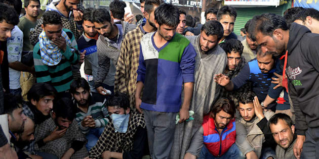 Kashmiri villagers surround the bodies of two civillians reported to have been killed in clashes with security personnel in Handwara, some 70kms north-west of Srinagar on April 12, 2016.