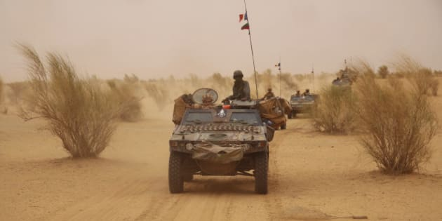 In this photo taken June 24, 2015, French forces patrol in the desert of Northern Mali along the border with Niger on the outskirts of Asongo, Northern Mali. French forces help to disarm groups in northern Mali after a peace deal reached. (AP Photo/Maeva Bambuck )