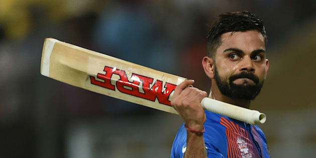 India's Virat Kohli walks off the pitch after the conclusion of their team innings during the World T20 semi-final match between India and West Indies at The Wankhede Cricket Stadium in Mumbai on March 31, 2016.