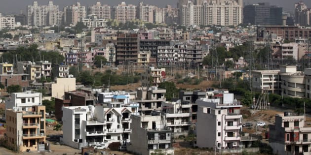 A general view of the residential apartments is pictured at Gurgaon, on the outskirts of New Delhi June 19, 2012. Welcome to Gurgaon, a city of wealthy urban professionals with gleaming shopping malls, five-star hotels and sprawling golf courses on the southern outskirts of New Delhi that is a symbol of newly affluent India. But crippling power and water shortages, crater-riddled roads and open sewage drains have made it an extreme example of the poor infrastructure that is constraining growth in Asia's third-largest economy. To match feature INDIA-INFRASTRUCTURE/GURGAON          REUTERS/Parivartan Sharma (INDIA - Tags: BUSINESS CONSTRUCTION SOCIETY)