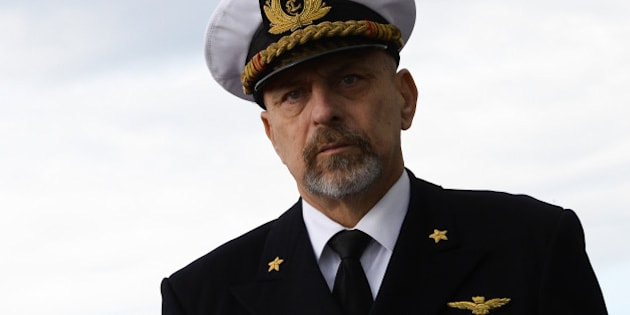Italian Navy chief of staff Admiral Giuseppe De Giorgi attends a ceremony marking the departure of the Cavour aircraft carrier from the Civitavecchia harbour for its mission 'A country on the move' on November 13, 2013. The carrier will be on a six-month tour that will include stops in 13 African countries and seven Gulf countries for commercial, diplomatic and humanitarian purposes. AFP PHOTO / ANDREAS SOLARO        (Photo credit should read ANDREAS SOLARO/AFP/Getty Images)