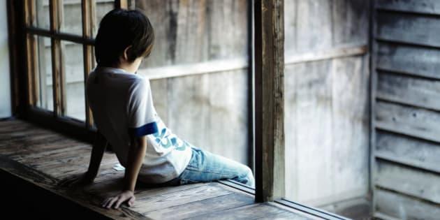 Boy sitting on the windowsill