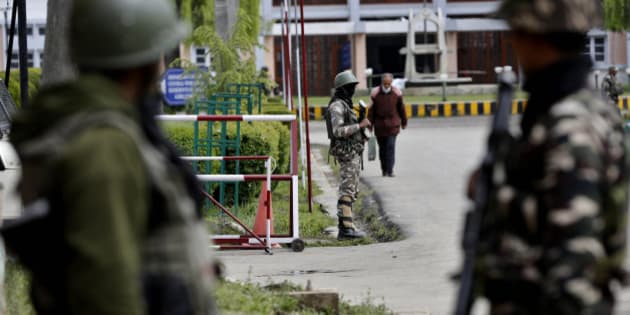 Indian paramilitary soldiers stand guard near the main gate of the National Institute of Technology (NIT), in Indian controlled Kashmir, Thursday, April 7, 2016. A clash took place between students of Kashmiri origin and others during the West Indies-India World Cup T20 semi-final match, after Kashmiri students allegedly celebrated India's loss. Classes had to be suspended after several students sustained injuries. (AP Photo/Mukhtar Khan)