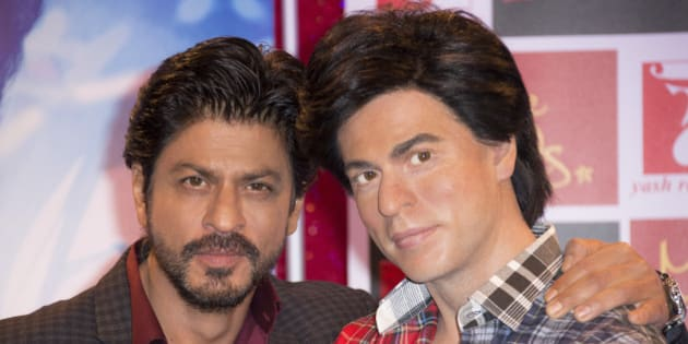 Actor Shah Rukh Khan, left, poses for photographers with his Madame Tussauds wax figure in central London ahead of the launch of Khan's new film 'Fan', Wednesday, April 13, 2016. (Photo by Joel Ryan/Invision/AP)