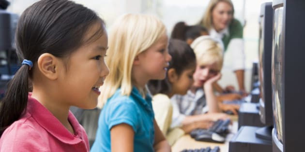 Kindergarten children learning how to use computer