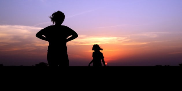 mother & daughter enjoying sunset.