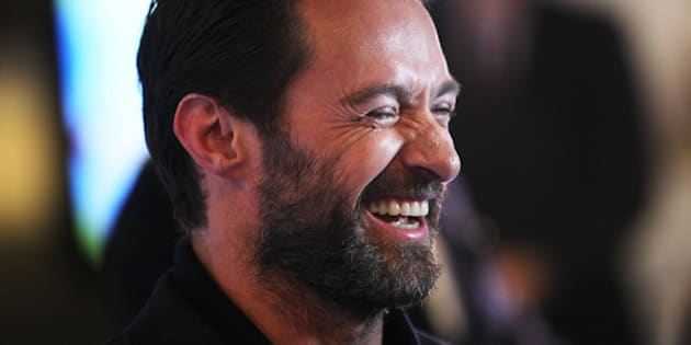 MELBOURNE, AUSTRALIA - MARCH 29:  Hugh Jackman smiles he arrives on the red carpet ahead of the Eddie The Eagle screening at Village Cinemas Crown on March 29, 2016 in Melbourne, Australia.  (Photo by Graham Denholm/Getty Images)