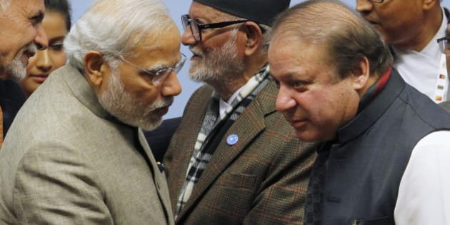 India's Prime Minister Narendra Modi (L) talks to his Pakistani counterpart Nawaz Sharif (R) during the closing session of 18th South Asian Association for Regional Cooperation (SAARC) summit in Kathmandu November 27, 2014. A brief meeting between India's Prime Minister Narendra Modi and his Pakistani counterpart appears to have salvaged a summit of South Asian leaders, with all eight countries clinching a last-minute deal to create a regional electricity grid.  REUTERS/Niranjan Shrestha/Pool (NEPAL - Tags: POLITICS)