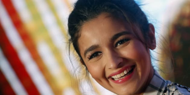 "Indian Bollywood actress Alia Bhatt smiles during the song launch of her movie ""Shaandaar"" in Mumbai, India, Tuesday, Oct. 13, 2015. The film is scheduled for release on Oct. 22. (AP Photo/Rajanish Kakade)"