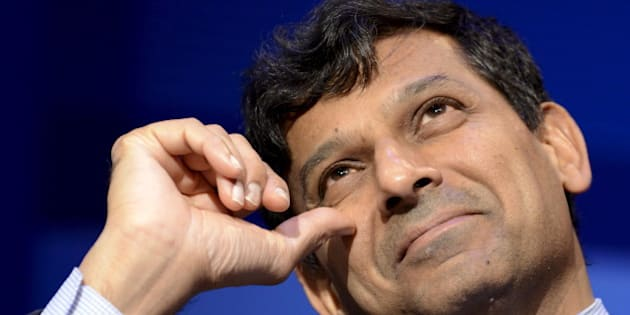 "India's Reserve Bank Governor Raghuram Rajan looks up as he listens to remarks during a seminar on ""The New Normal in Asia: Will Growth Inevitably Slow?"" at the IMF and World Bank's 2015 Annual Spring Meetings, in Washington, April 16, 2015. REUTERS/Mike Theiler"