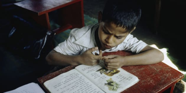 India, Madhya Pradesh, Bhopal, boy studying at school