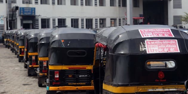 MUMBAI, INDIA - JUNE 17: Auto-rickshaws parked along a road as they went on day-long statewide strike called by the Mumbai Autorickshaw-Taximen's Union (MAU), demand ouster of call center-operated Uber and Ola cabs besides revocation of Maharashtra government's decision to scrap the Hakim panel on auto and taxi fares, at Bandra on June 17, 2015 in Mumbai, India. MAU, the largest auto union in the city, has appealed to 15 lakh autorickshaw men across the state to join the stir, which may hit lakhs of commuters as it claims to have 95% of the auto owners under its wing. (Photo by Satish Bate/Hindustan Times via Getty Images)