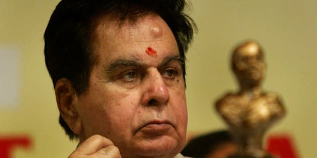 Veteran Bollywood actor Dilip Kumar looks on at a ceremony where he was awarded the Phalke Ratna for his services to the Indian film industry in Mumbai, India, Monday, April 30, 2007. The Phalke Ratna is presented by the Dadasaheb Phalke Academy, named after Dadasaheb Phalke, considered to be the founder of Indian cinema, is an all India body of 36 cine associations. In the foreground is a bust of Dadasaheb Phalke. (AP Photo/Gautam Singh)