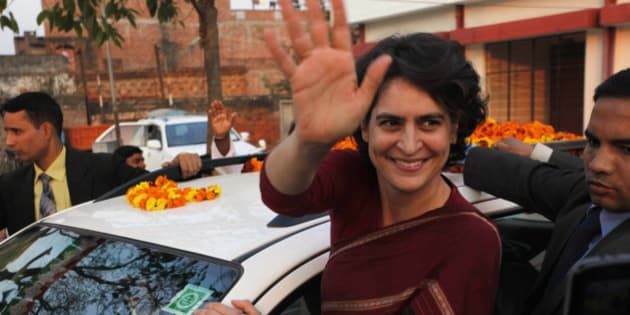 India's ruling Congress party president Sonia Gandhi's popular daughter Priyanka Gandhi Vadra waves during an election rally at Musafirkhana, in Sultanpur district, in the northern Indian state of Uttar Pradesh, Friday, Feb. 3, 2012. India's biggest state, Uttar Pradesh will go for polling in seven phases starting from Feb. 8. 2012. (AP Photo/Rajesh Kumar Singh)