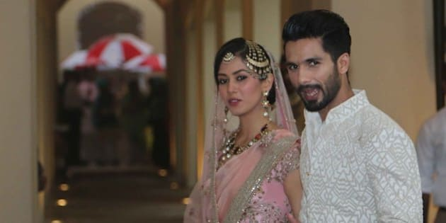 GURGAON, INDIA - JULY 7: Bollywood actor Shahid Kapoor with his wife Mira Rajput poses for his first photo op post wedding on July 7 at Hotel Trident on July 7, 2015 in Gurgaon, India. (Photo by Waseem Gashroo/Hindustan Times via Getty Images)